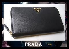 PRADA ラウンドファ長財布 ブラックXゴールド1M0506 サフィアーノ 85320円 新品