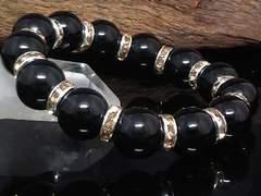 天然ブラックオニキス12ミリ黄ロンデル数珠