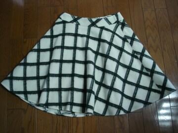クイーンズコート 大人かわいいウールチェックフレアースカート